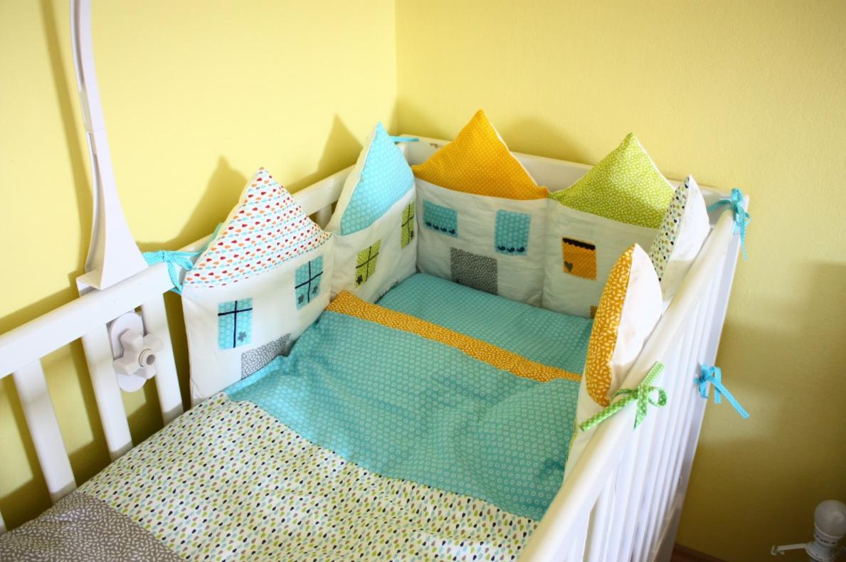 obrobe za otroško posteljico